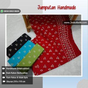 kain batik motif jumputan warna merah